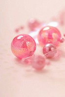 Decorative pink beads, close-up