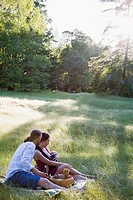 Family with picnic in meadow
