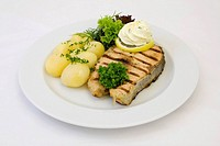Grilled salmon filet with herb butter, potatoes with parsley