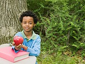 Portrait of a boy holding an apple