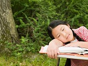 A girl asleep on a desk
