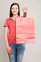 Woman holding a red shopping bag