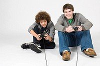 Teenager boys playing video game