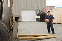 Worker in loading bay