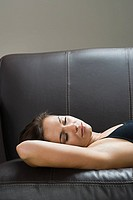 Woman sleeping on sofa (thumbnail)