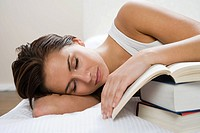 Sleeping woman with books