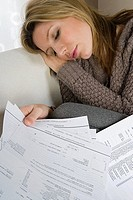 Sleeping woman with bills