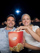 A couple watching a movie (thumbnail)