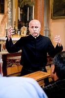 Monk guiding a tour, San Lazzaro degli Armeni, Venetian Lagoon, Italy, Europe