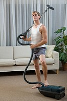 Portrait of a man with a vacuum cleaner