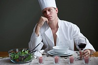 Portrait of a man in chefs outfit and a romantic meal