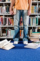 Student and books in library