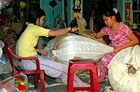 Young women making traditional Chinese silk lanterns, Hoi An, Vietnam, Asia