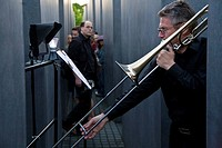 Trombonist during the world premiere of the composition Vor dem Verstummen by Harald Weiss, Holocaust Memorial, Berlin, Germany, Europe
