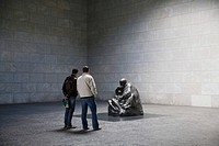 Interior room of the Neue Wache, two men viewing a sculpture by Kaethe Kollwitz, Berlin_Mitte, Germany, Europe