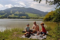 Family picnic at Lake Gruentensee, East Allgaeu, Swabia, Bavaria, Germany, Europe