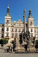 Statue in front of ornate building facade in the historic centre of Pardubice, East Bohemia, Czech Republic, Czechia, Europe
