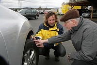 Dirk Mueller, ADAC German automobile club instructor explaining the importance of the correct tire tread depth and air pressure to a participant in th...
