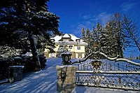 Luxurious villa with a wrought-iron gate in winter, Schluchsee Lake, southern Black Forest, Baden-Wuerttemberg, Germany, Europe