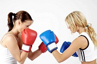 Two female boxers fighting each other