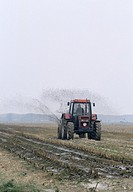 Farmer spreading manure on a field, Netherlands, Europe