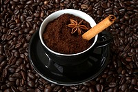 Cup with espresso, coffee beans and cinnamon stick
