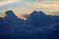 Sun setting behind clouds in sky (thumbnail)