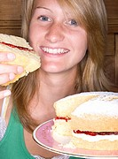 Close up of girl holding victorian sponge cake