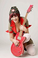 Rocker girl dressed as a nurse with a guitar
