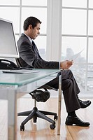Businessman reading document at his desk