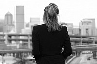 Businesswoman looking at cityscape
