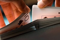 Close up of mans hands shuffling playing cards