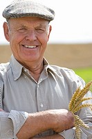 Farmer holding wheat stalk