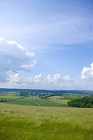 Clouds in blue sky over countryside