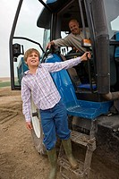 Boy leaning out of tractor