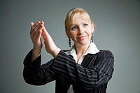 A woman clapping.