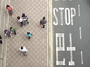 People walking past ´Stop´ sign, Hong Kong, China