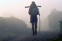A pilgrim on the Camino de Santiago Camino Frances route by passing Portomarín
