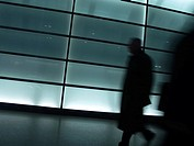 Silhouette of person walking in tunnel, Potsdamer Platz, Berlin, Germany