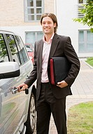 Business man getting into car