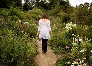 A female walking through a garden