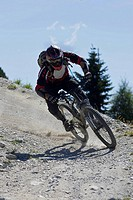 Downhill mountain biker riding fast