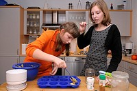Girls baking muffins