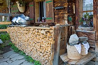 Woodpile, firewood and cheesemaker's tools, Draugsteinalm (Draugstein mountain pasture), Grossarltal (Grossarl Valley), Salzburg, Austria, Europe
