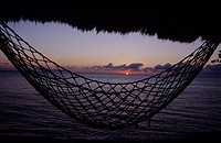 hammock in front of the sun rise