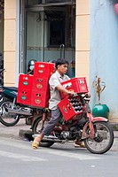 Beer crates transported on a motorbike, Ho Chi Minh City (Saigon), Vietnam, Asia