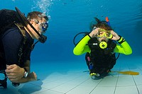 Girl taking scuba lessons in a swimming pool, Indonesia, Asia