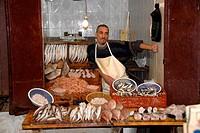 Fish vendor medina Fes El Bali Morocco