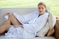 Woman in bathrobe relaxing