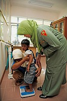 INDONESIA  Government health clinic Pos Kesmas at Cot Seumereng, Desa Pucoh Leung  Weighing a child  Meulaboh, Aceh